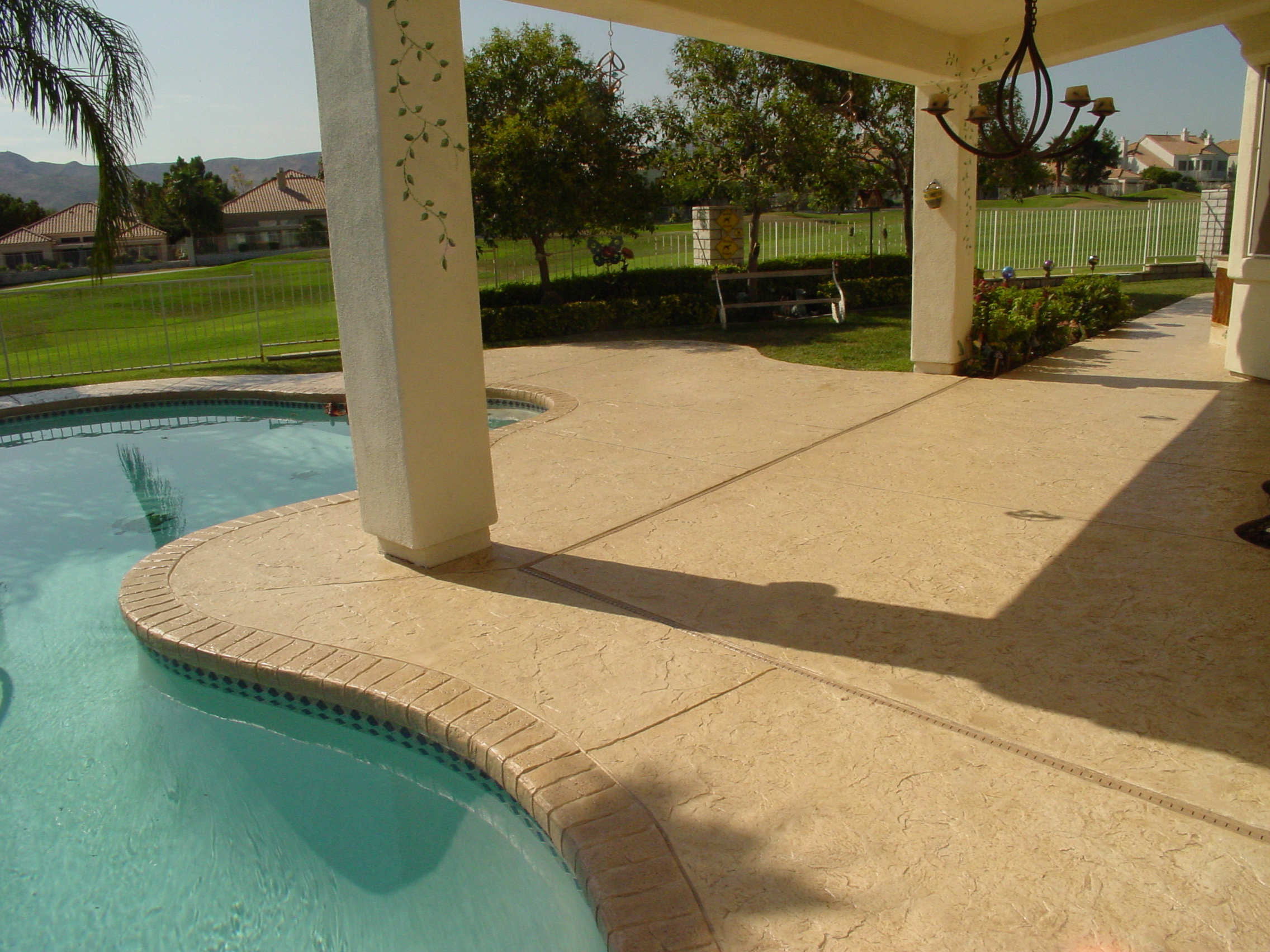 Americrete pool deck with cements and stains